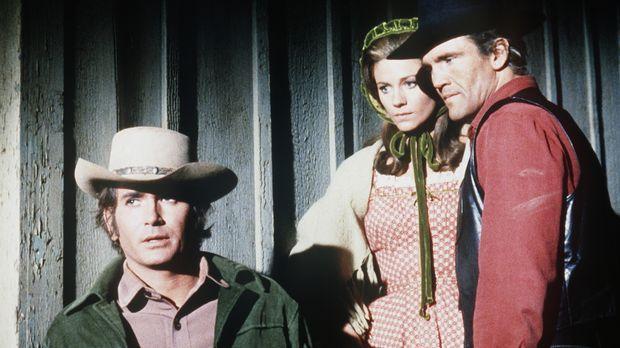 Little Joe (Michael Landon, l.) und Candy (David Canary, r.) wollen Barbara (...