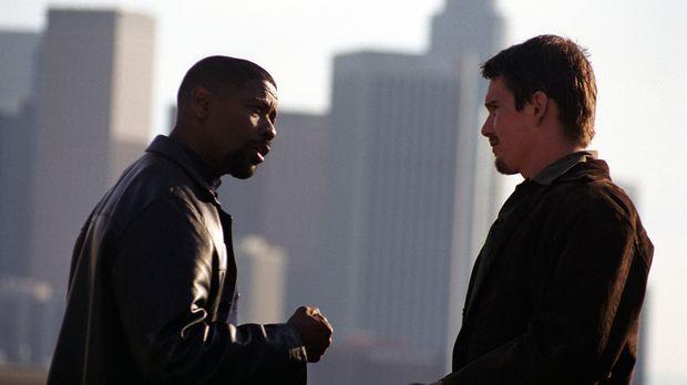 Ein ungleiches Team: der korrupte Cop Alonzo Harris (Denzel Washington, l.) u...