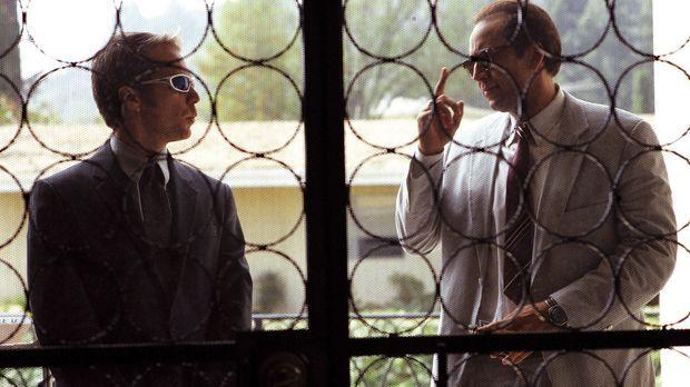 Roy (Nicolas Cage, r.) und Frank (Sam Rockwell, l.) verdienen sich ihren Lebe...
