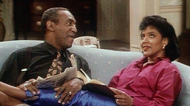 Cliff (Bill Cosby, l.) bemüht sich, Clair (Phylicia Rashad, r.) beim Lösen ei...