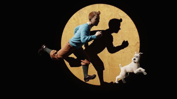 Erleben ein ganz besonderes Abenteuer: Tim (l.) und Struppi (r.) ... © 2011 C...